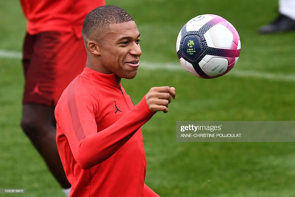 Paris Saint-Germain's French forward Kylian Mbappe takes part in a training session at the team's 'Camp des Loges' training grounds in Saint-Germain-en-Laye, west of Paris, on September 13, 2018, on the eve of the French L1 football match between Paris Saint-Germain (PSG) and Saint-Etienne (ASSE).