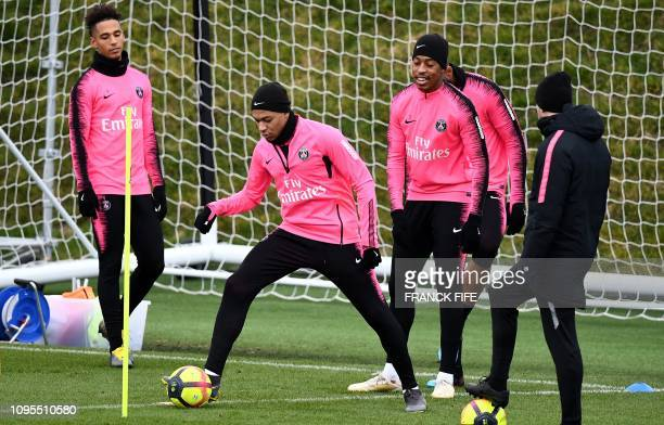 Paris SaintGermain's French forward Kylian MBappe takes part in a training session at the team's Camp des Loges training grounds in...