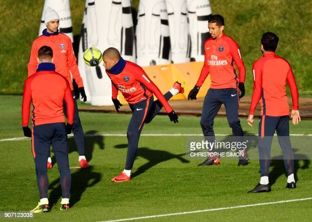 Paris SaintGermain's French forward Kylian Mbappe takes part in a training session at the club's training ground in SaintGermainenLaye on January 19...