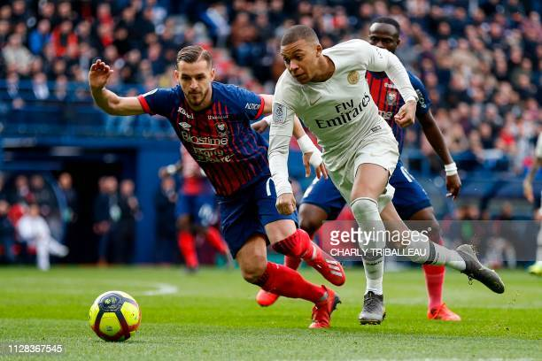 Paris SaintGermain's French forward Kylian Mbappe vies for the ball with Caen's French defender Jonathan Gradit during the French L1 football match...