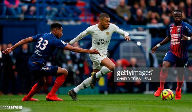 Paris SaintGermain's French forward Kylian Mbappe vies for the ball with Paris SaintGermain's French forward Antoine Bernede during the French L1...