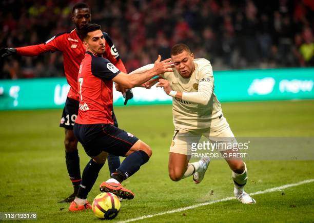TOPSHOT Paris SaintGermain's French forward Kylian Mbappe vies for the ball with Lille's Portuguese forward Rafael Leao during the French L1 football...