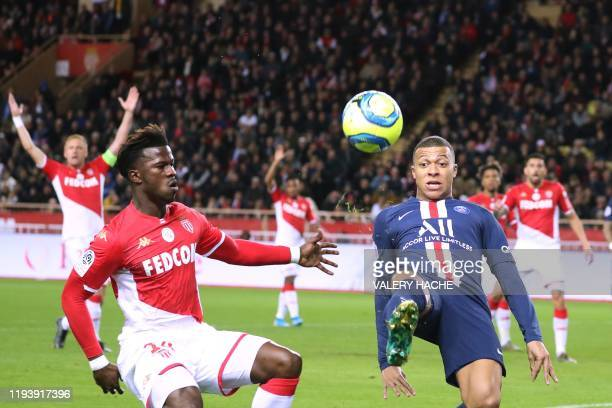 Paris SaintGermain's French forward Kylian Mbappe vies for the ball with Monaco's Senegalese forward Keita Balde during the French L1 football match...