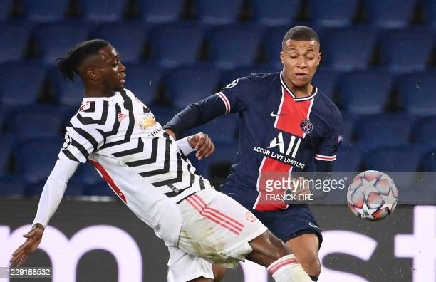 Paris SaintGermain's French forward Kylian Mbappe vies for the ball with Manchester United's English defender Aaron WanBissaka during the UEFA...