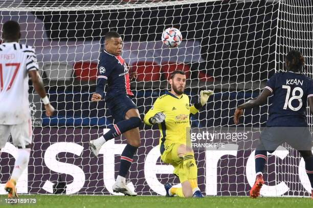 Paris SaintGermain's French forward Kylian Mbappe vies for the ball with Manchester United's Spanish goalkeeper David de Gea during the UEFA...
