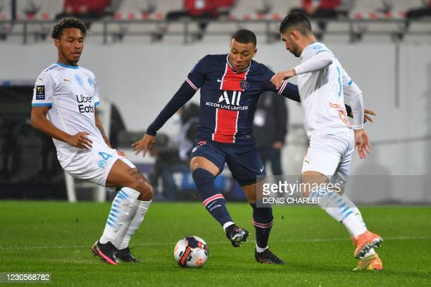 Paris Saint-Germain's French forward Kylian Mbappe vies for the ball with Marseille's Spanish defender Alvaro Gonzalez and Marseille's French...