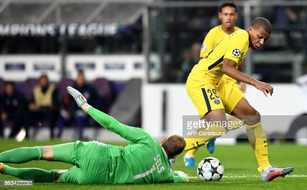 Paris SaintGermain's French forward Kylian Mbappe vies for the ball with with Anderlecht's Belgian goalkeeper Matz Sels in front Paris SaintGermain's...
