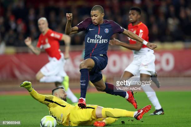 TOPSHOT Paris SaintGermain's French forward Kylian Mbappe vies for the ball with Monaco's Croatian goalkeeper Danijel Subasic during the French L1...