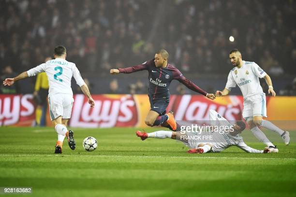TOPSHOT Paris SaintGermain's French forward Kylian Mbappe vies for the ball with Real Madrid's Spanish defender Dani Carvajal Real Madrid's Spanish...