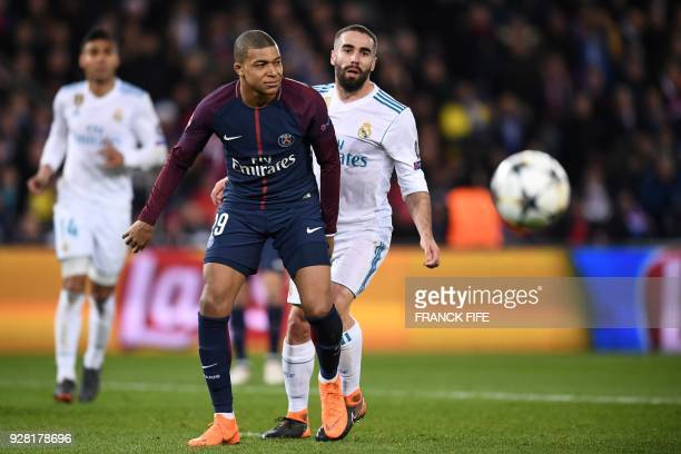 Paris SaintGermain's French forward Kylian Mbappe vies for the ball with Real Madrid's Spanish defender Dani Carvajal during the UEFA Champions...