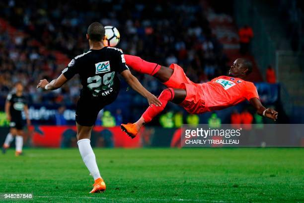 Paris SaintGermain's French forward Kylian Mbappe vies for the ball with Caen's Ivorian forward Christian Kouakou during the French cup semifinal...