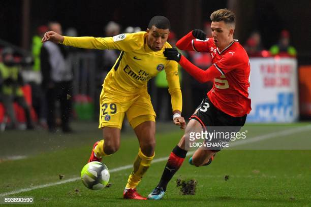 Paris SaintGermain's French forward Kylian Mbappe vies with Rennes'French midfielder Adrien Hunou during the French L1 football match between Rennes...