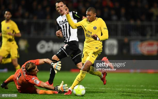 Paris SaintGermain's French forward Kylian Mbappe vies with Angers' Serbian goalkeeper Denis Petric before scoring a goal during the French Ligue 1...