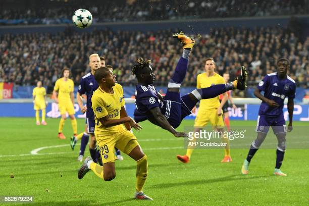 Paris SaintGermain's French forward Kylian Mbappe vies with Anderlecht's Senegalese defender Serigne Mbodji during the UEFA Champions League Group B...