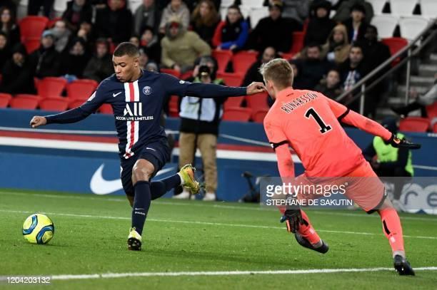 Paris Saint-Germain's French forward Kylian Mbappe vies with Dijon's Icelandic goalkeeper Runar Runarsson during the French L1 football match between...