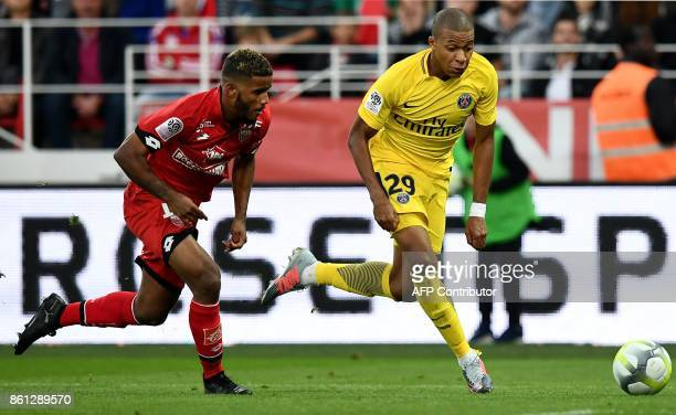 Paris SaintGermain's French forward Kylian Mbappe vies with Dijon's French defender Valentin Rosier during the French L1 football match between Dijon...