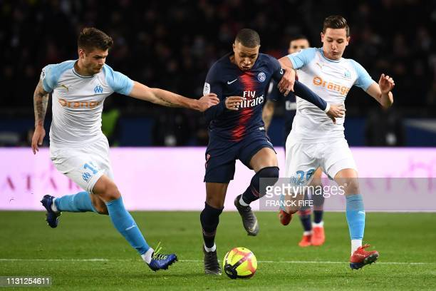 TOPSHOT Paris SaintGermain's French forward Kylian Mbappe vies with Marseille's Croatian defender Duje Caleta Car and Marseille's French forward...