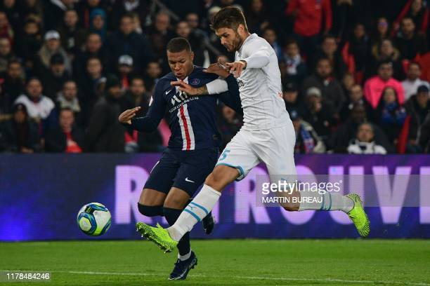 Paris SaintGermain's French forward Kylian Mbappe vies with Marseille's Croatian defender Duje Caleta Car during the French L1 football match between...