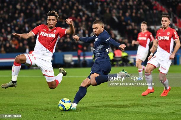 Paris Saint-Germain's French forward Kylian Mbappe vies with Monaco's German midfielder Benjamin Henrichs during the French L1 football match between...
