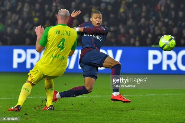 Paris SaintGermain's French forward Kylian Mbappe vies with Nantes' French defender Nicolas Pallois during the French L1 football match between...