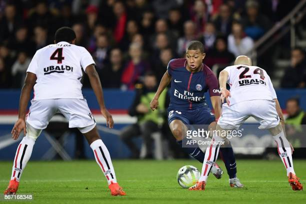 Paris SaintGermain's French forward Kylian Mbappe vies with Nice's Brazilian defender Santos Marlon and Nice's French defender Christophe Jallet...