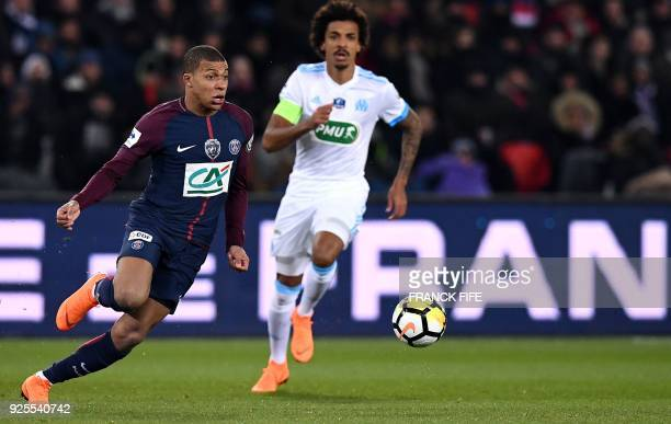 Paris SaintGermain's French forward Kylian MBappe vies with Olympique Marseille's Brazilian midfielder Luiz Gustavo during the French Cup...