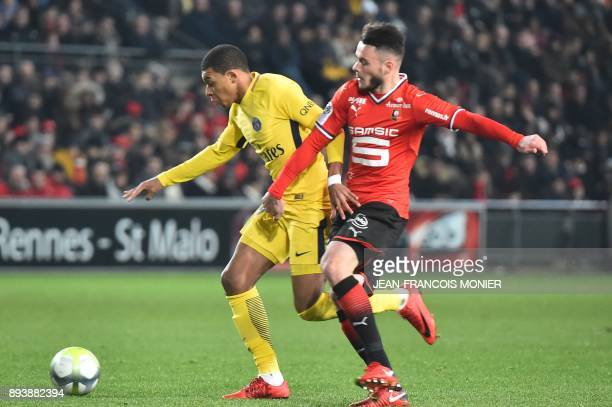 Paris SaintGermain's French forward Kylian Mbappe vies with Rennes' French midfielder Jeremy Gelin during the French L1 football match between Rennes...