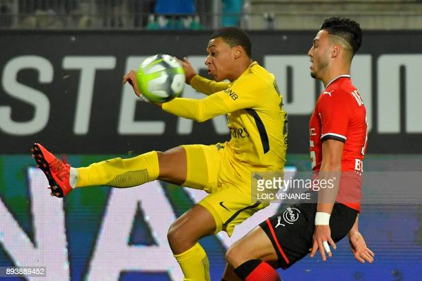 Paris SaintGermain's French forward Kylian Mbappe vies with Rennes' Algerian defender Ramy Bensebaini during the French L1 football match between...