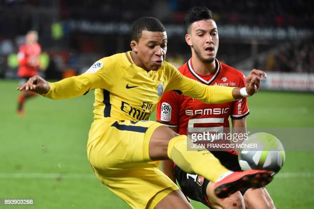 Paris SaintGermain's French forward Kylian Mbappe vies with Rennes' Algeria defender Ramy Bensebaini during the French L1 football match between...