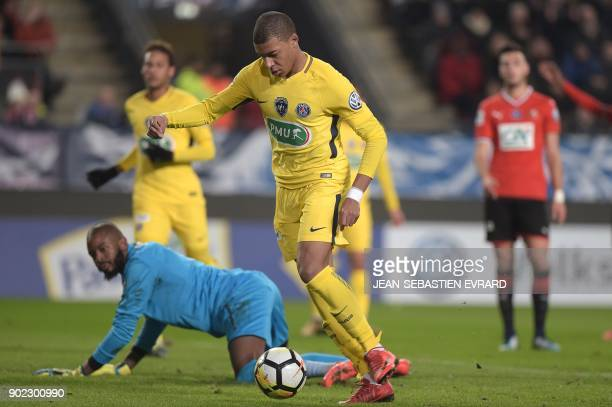 Paris SaintGermain's French forward Kylian Mbappe vies with Rennes' French goalkeeper Abdoulaye Diallo during the French Cup football match between...