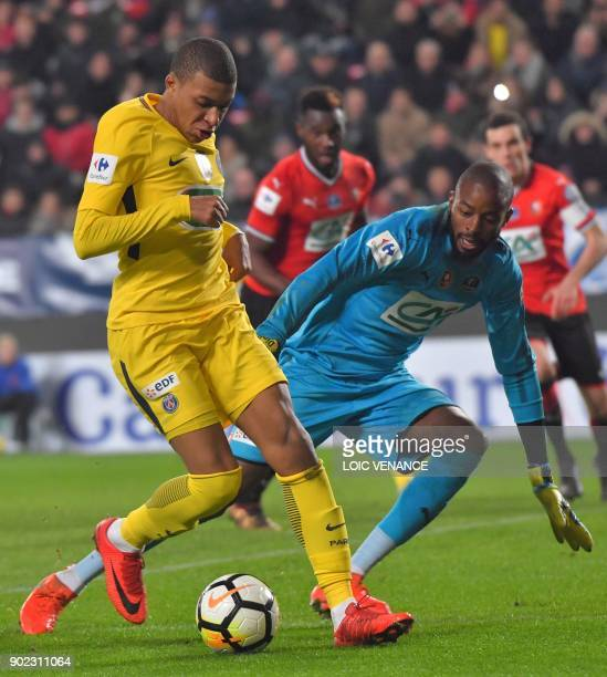 Paris SaintGermain's French forward Kylian Mbappe vies with Rennes' French goalkeeper Abdoulaye Diallo during the French cup football match Rennes vs...