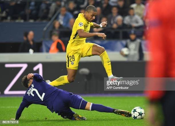 Paris SaintGermain's French forward Kylian Mbappe vies withAnderlecht's Portuguese defender Josue Sa during the UEFA Champions League Group B...