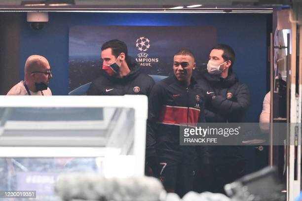 Paris Saint-Germain's French forward Kylian Mbappe waits after the game was suspended in the first half as the players walked off amid allegations of...