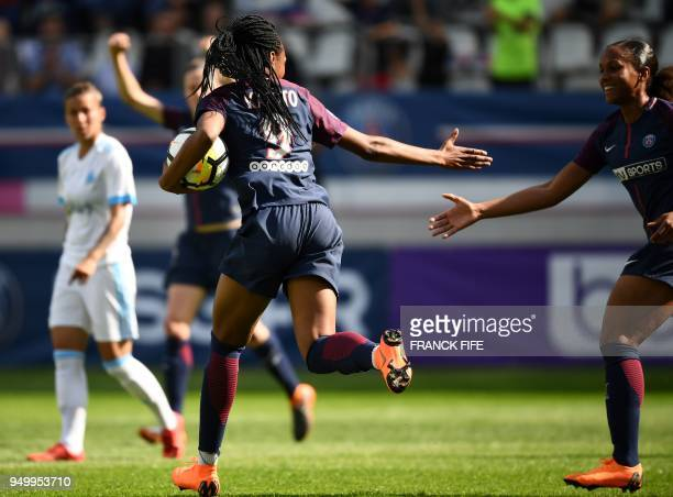 Paris SaintGermain's French forward Marie Antoinette Katoto celebrates with teammates after scoring a goal during the French D1 Women's football...