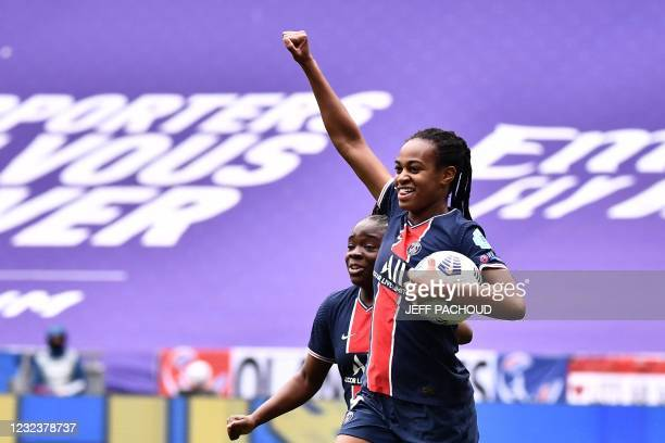 Paris Saint-Germains French forward Marie-Antoinette Katoto and Paris Saint-Germains French forward Oceane Hurtre celebrate after Lyons French...