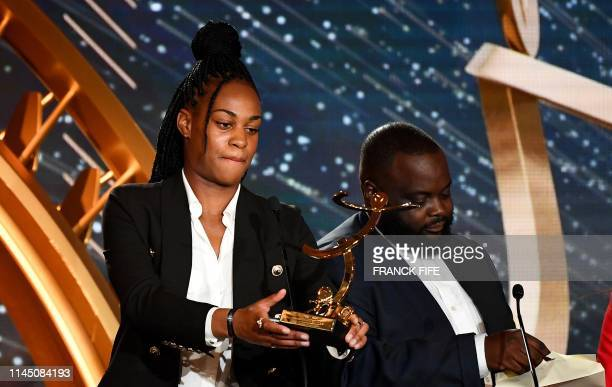Paris SaintGermain's French forward MarieAntoinette Katoto receives the best hope female player award on May 19 2019 in Paris during the 28th edition...