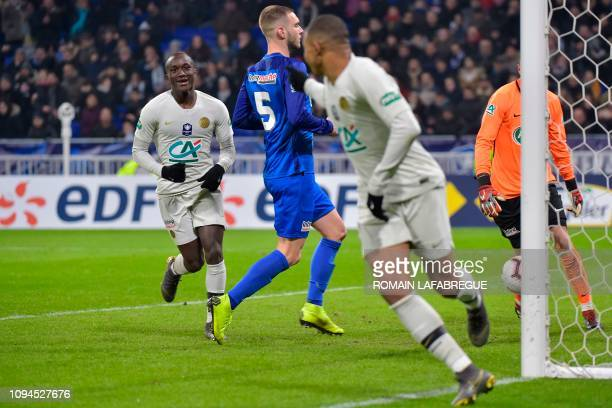Paris SaintGermain's French forward Moussa Diaby celebrates after scoring a goal as Paris SaintGermain's French forward Kylian Mbappe gestures during...