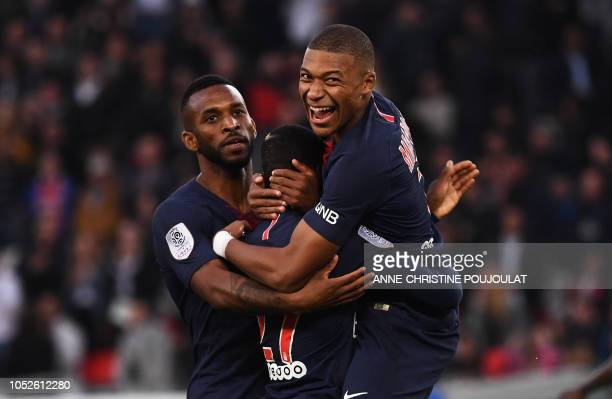 TOPSHOT Paris SaintGermain's French forward Moussa Diaby celebrates with Paris SaintGermain's French forward Kylian Mbappé and Paris SaintGermain's...