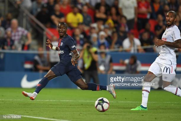 Paris SaintGermain's French forward Moussa Diaby gestures as he eyes the ball during the French L1 football match between Paris SaintGermain and Caen...