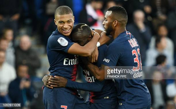 TOPSHOT Paris SaintGermain's French forward Moussa Diaby is congratulated by Paris SaintGermain's French forward Kylian Mbappe and Paris...