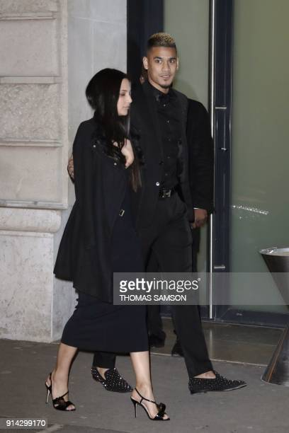 Paris SaintGermain's French goalkeeper Alphonse Areola and his wife Marrion Areola arrive at the Pavillon Cambon in Paris to attend the birthday...