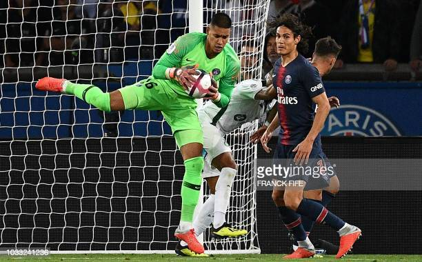 Paris Saint-Germain's French goalkeeper Alphonse Areola catches the ball during the French L1 football match between Paris Saint-Germain and...