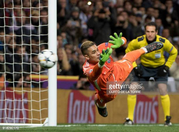 TOPSHOT Paris SaintGermain's French goalkeeper Alphonse Areola concedes a goal during the UEFA Champions League round of sixteen first leg football...