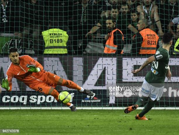 Paris SaintGermain's French goalkeeper Alphonse Areola deflects a penalty kick shot by SaintEtienne's French forward Remy Cabella during the French...
