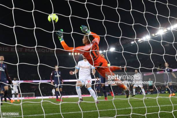 Paris SaintGermain's French goalkeeper Alphonse Areola dives for the ball during the French L1 football match between Paris SaintGermain and...