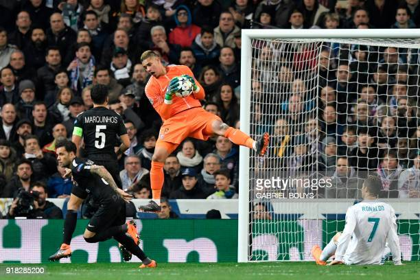 TOPSHOT Paris SaintGermain's French goalkeeper Alphonse Areola grabs the ball during the UEFA Champions League round of sixteen first leg football...