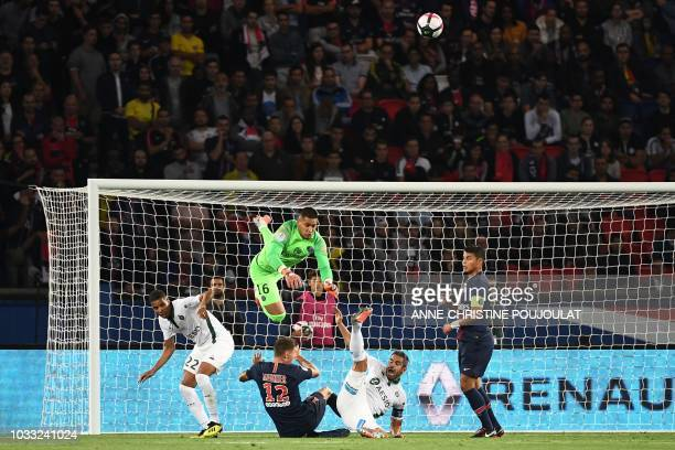Paris Saint-Germain's French goalkeeper Alphonse Areola jumps for the ball during the French L1 football match between Paris Saint-Germain and...