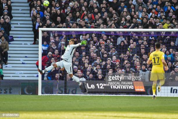 Paris SaintGermain's French goalkeeper Alphonse Areola jumps to make a save during the French L1 football match between Toulouse and Paris...