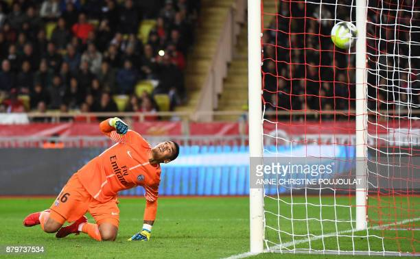 Paris SaintGermain's French goalkeeper Alphonse Areola looks at the ball following the shoot by Monaco's Portuguese midfielder Joao Moutinho during...