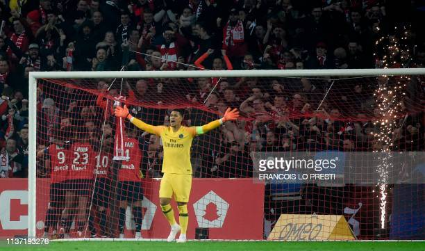 Paris SaintGermain's French goalkeeper Alphonse Areola reacts after conceding a goal during the French L1 football match between Lille and Paris...
